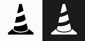 Traffic Cone Icon on Black and White Vector Backgrounds. This vector illustration includes two variations of the icon one in black on a light background on the left and another version in white on a dark background positioned on the right. The vector icon is simple yet elegant and can be used in a variety of ways including website or mobile application icon. This royalty free image is 100% vector based and all design elements can be scaled to any size.
