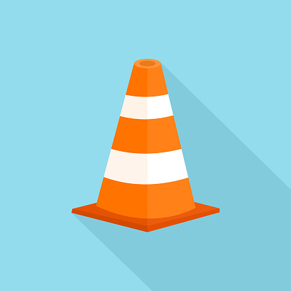 Traffic Cone with long shadow isolate on blue background.