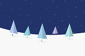 Minimalistic Christmas scene with night sky and fir trees.