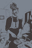 Transgender man baking cookies and wearing Mistletoe headband