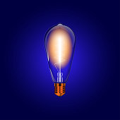 Transparent vector realistic light bulb isolated on blue background