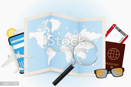 istock Travel destination Vietnam, tourism mockup with travel equipment and world map with magnifying glass on a Vietnam. 1320471632