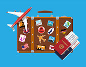 Travel suitcase with stickers and aircraft