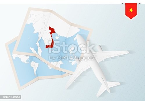 istock Travel to Vietnam, top view airplane with map and flag of Vietnam. 1302393544