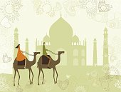 Couple riding a camell on their visit to Taj Mahal in India. Grouped and layered file for easy edition..