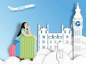 Travelling woman with suitcase on London background ,  paper cut style .candy color vector style.