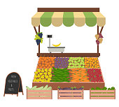 Tray with vegetables and fruits on the market. Workplace of the market seller. There is scales and goods: cucumbers, onions, carrots, eggplant, zucchini, apples, plums, grapes in the image. Vector
