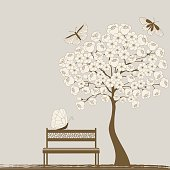 Tree and butterflies and bench