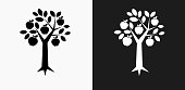 Tree Apple Icon on Black and White Vector Backgrounds. This vector illustration includes two variations of the icon one in black on a light background on the left and another version in white on a dark background positioned on the right. The vector icon is simple yet elegant and can be used in a variety of ways including website or mobile application icon. This royalty free image is 100% vector based and all design elements can be scaled to any size.