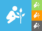 Tree Planting   Flat Icon on Blue Background. The icon is depicted on Blue Background. There are three more background color variations included in this file. The icon is rendered in white color and the background is blue.