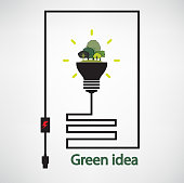 trees and green light bulb on background,green concepts