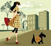 Illustration of a girl walking her dog through the city.  Illustration, 300 dpi, 20 x 18 inch EPS, AI (vector), JPEG (High, medium and low resolution) included
