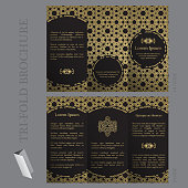 Tri-fold brochure template with ottoman arabesque pattern in gold and black colors