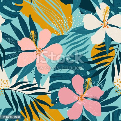 istock Tropical flowers and artistic palm leaves on background. Seamless. Vector pattern. 1267491534