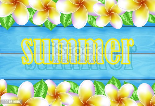 Tropical frangipani flowers and shabby wooden blue background, summer concept. Summer decoration with realistic tropical elements. Concept of seasonal vacation in tropical country.