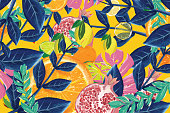 Tropical fruit and leaves, summer background composition vibrant colors