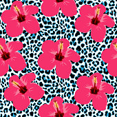 Tropical seamless background with hibiscus flowers and leopard pattern