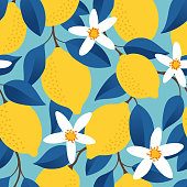istock Tropical seamless pattern with yellow lemons. Fruit repeated background. Vector bright print for fabric or wallpaper. 1216591608