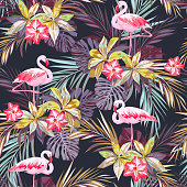 Tropical summer seamless pattern with flamingo birds and exotic plants, vector illustration