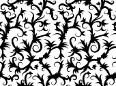 Seamless background of swirling tropical vines in black and white. Print for fabric.