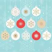 Twelve stylish hanging christmas baubles on a blue snowflake silhouette background.