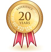 Gold honorary twenty years experience medal.