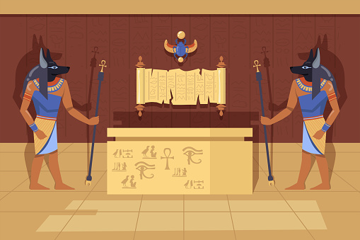 Two Anubis deities with ankh walking canes next to mummy case