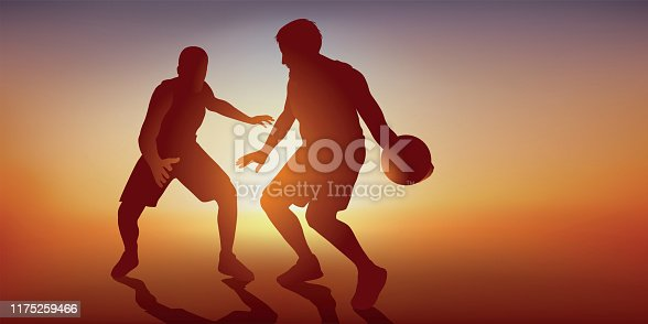 istock Two basketball players face each other face to face in a championship game. 1175259466