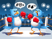 Vector illustration of two angry blue birds fighting in a boxing ring, screaming at each other. Concept for outrage on social media, bullying, heated discussions on the internet, online harassment and hashtag movements.