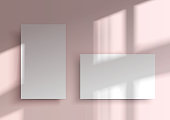 Two business cards. Mockup of Overlay shadow from the window. Natural light shadow over the top. Realistic vector illustration. An abstract scene with a pink background in a minimalist style.