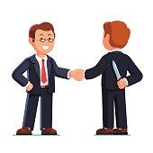 Two business man shaking hands. Betrayal metaphor.