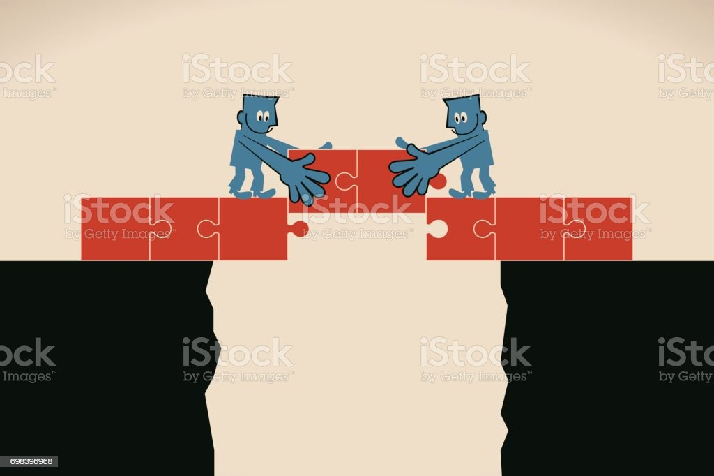 Two Businessmen Holding Jigsaw Puzzles To Connect On The