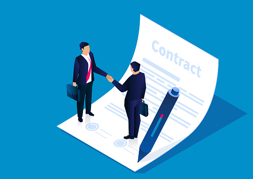 Two businessmen shaking hands to reach an agreement and successfully sign the contract, the concept of business cooperation
