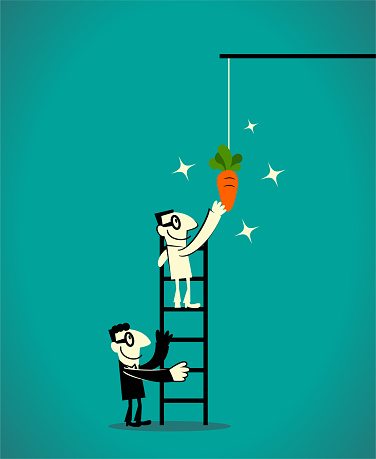 Two businessmen using a ladder to catch the dangling carrot at the end of a stick