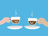 Two cups of Coffee with man hand with woman hand