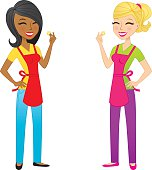 African American and blond woman wearing aprons and snapping