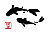 istock Two fish drawn in the style of Chinese or Japanese painting with strokes of black paint. 1218442379