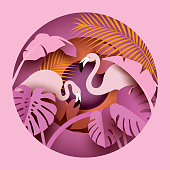Two flamingos in tropical leaves.