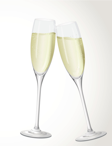 Two flutes of champagne clinking in cheers