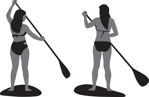 Two Girls Paddle Boarding Silhouette