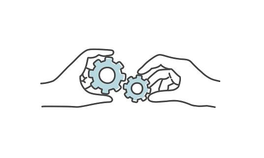 Two hands holding cogwheel.