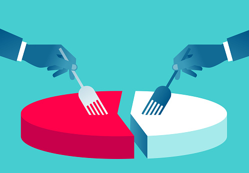Two hands holding fork to split pie chart, concept of business profit