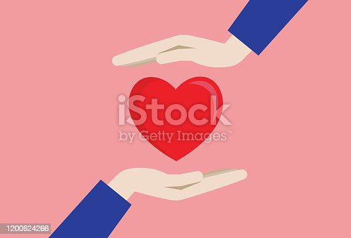 istock Two hands with a red heart 1200624266