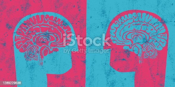 istock Two Heads Confronting Concept 1289229538
