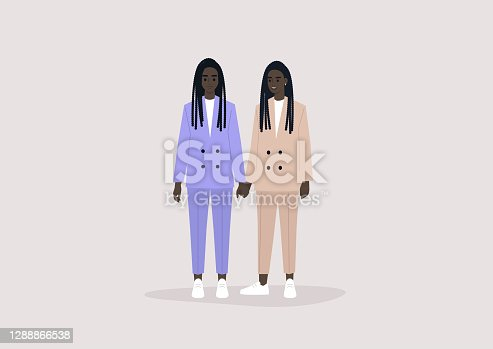 istock Two identical twin Black sisters wearing pastel suits and holding hands 1288866538