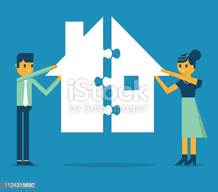Businessman and businesswoman with house puzzle