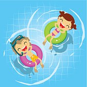 Two kids in the swimming pool