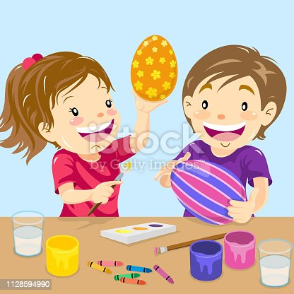Two kids painting easter eggs.