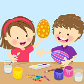 Kids painting Easter eggs.