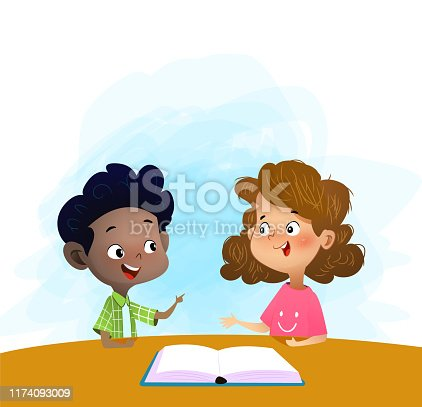 istock Two kids talking and discuss book in library. 1174093009